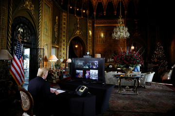 U.S. President Donald Trump participates in a Christmas Eve video teleconference with members of the military at Mar-a-Lago estate in Palm Beach, Florida