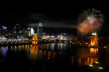 Fireworks explode over the Ohio River in Cincinnati