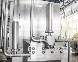 unit is made of stainless pipes. Welding, nuts, bolts, crane. Plant for food production
