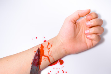 Knife with arm and blood stain
