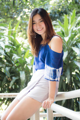 Beautiful young adult thai chinese blue tank top relax and smile