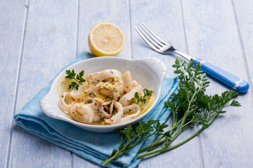 rings squid with parsley and grated lemon peel