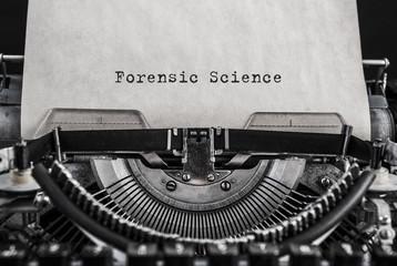 Forensic Science words typed on vintage typewriter. Close up