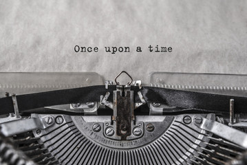 Once upon a time typed words on a vintage typewriter. Close up