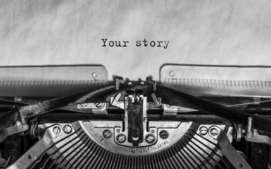 your story typed words on a Vintage Typewriter. Mechanisms closeup. Typing on old typewriter