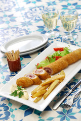 flamenquin, deep fried long pork roulade, spanish cordoba cuisine