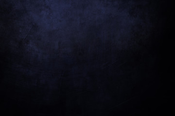 black and blue grungy background with spotlight background