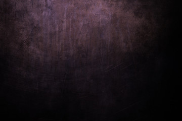 dark purple grungy background with spotlight background