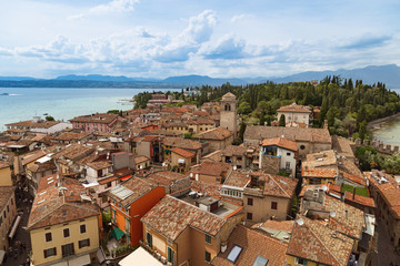 View of small Italian town Sirmione on top of the Scaliger castle. Italian urban landscape in lake Garda.