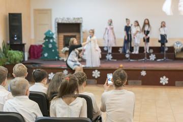 Little children perform on stage