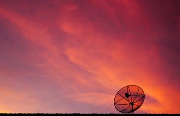 Satellite dish on twilight sky