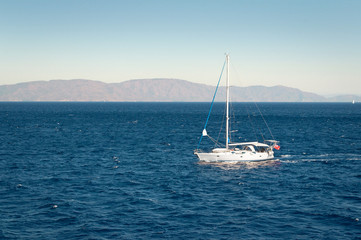 A yacht in the Mediterranean sea on blue sky background