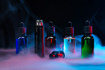jars of liquids for vape in multi-colored smoke Wall mural