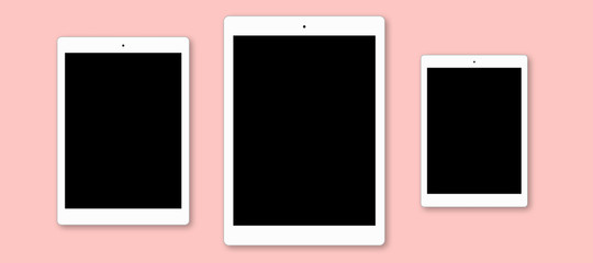 Three modern tablet computers on pink background. Modern gadgets on flat layout. Electonic devices with blank copy screens for your advertisment, present application