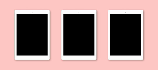 Top view of modern tablet computers with blank screens, isolated on pink background. Flat lay. Realistic gadgets to present your application design. Up to date device