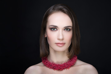 woman red necklace
