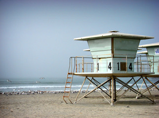 aged and worn lifeguard stand on beach