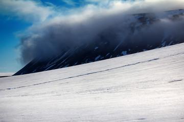 Fotobehang Poolcirkel Cloud caught on the glacial sheet, nunatak in fog