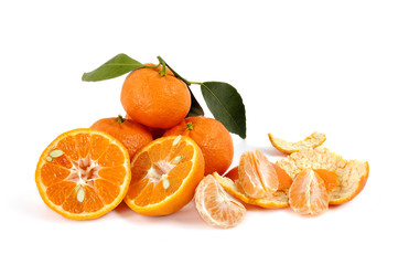 Fresh tangerines with leaves on white background