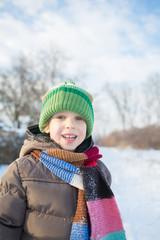 Little boy in winter day