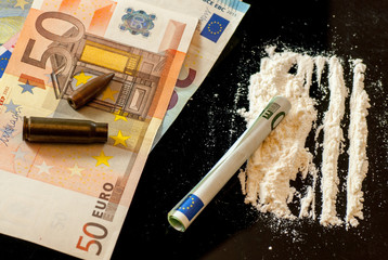 cartridge bullet euro banknotes and heroin international drug traffic terrorism financing concept