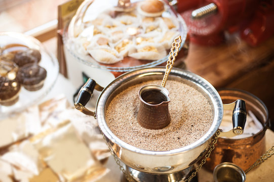 The process of Turkish coffee preparation in a coffee shop in Tirana, Albania