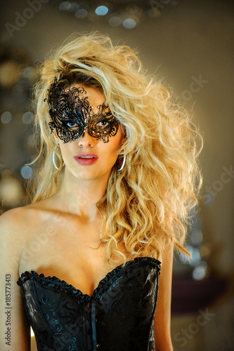 a009a226cf2 Portrait of beautiful sexy elegant young lady wearing black corset and  Venetian mask.
