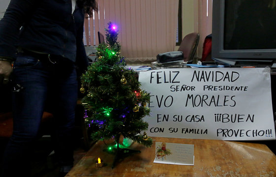 "A sign next to a Christmas tree reads "" Merry Christmas, Mister President Evo Morales and your family at home, Bon Appetit"" during a strike to protest against Bolivia's government new health care policies in La Paz"