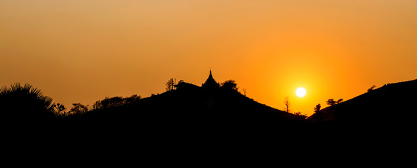 Silhouette of the temple on the top of the hill in Myanmar, Sunset on the hill with buddist pagoda, Asia