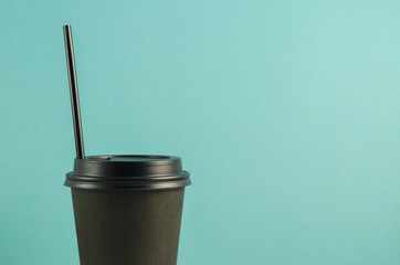 Closed Coffee Cup on blue background.