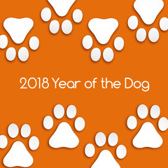 Dog footprints cut paper with soft shadow. Year of the dog.