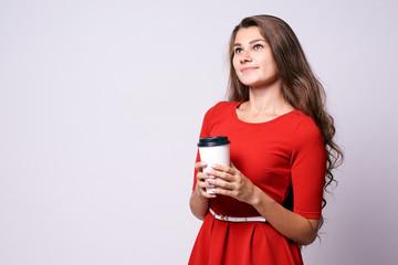 White glass. Hot coffee. Portrait girl. Red dress