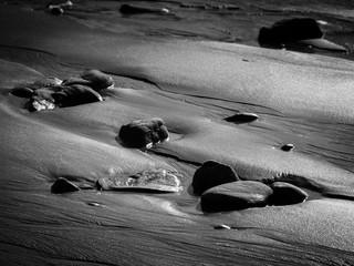 Galets ruisselant à marée basse