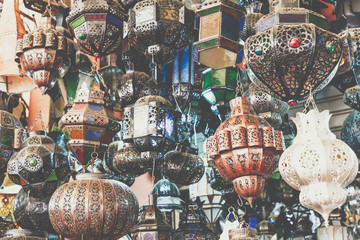 Shining moroccan metal lamps and souvenirs in the shop in medina of Marrakech, Morocco
