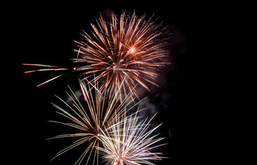 Firework blast in dark sky at night celebration new year,count down event,abstract lights explosion.