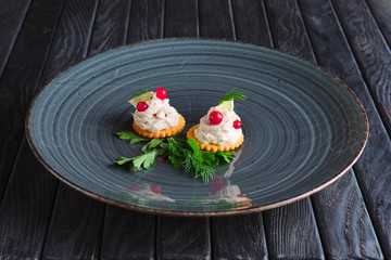Appetizer for reception.  Fish pate with lemon and cranberry