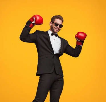 Man in suit and boxing gloves