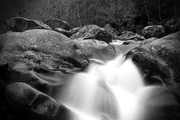 Blurred Motion and Slow Shutter Waterscape Black and White Photography of a River Waterfall in the Great Smoky Mountains.