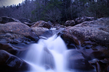 Slow Shutter Photography of a River Waterfall in the Woods of the Great Smokey Mountains National Park.