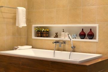 Brown bathroom including bath