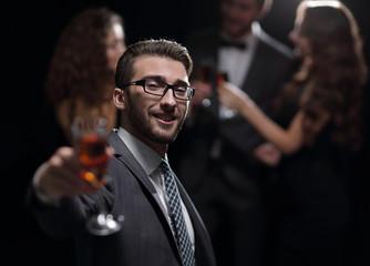 elegant man raising his glass with the toast