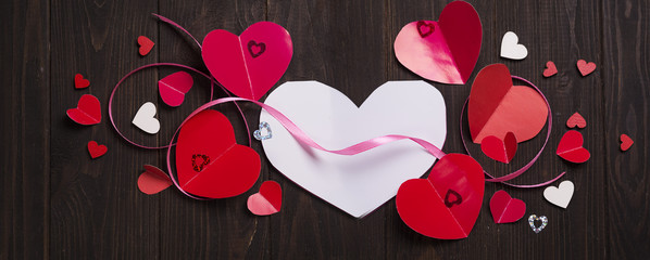 Red paper hearts media love putting