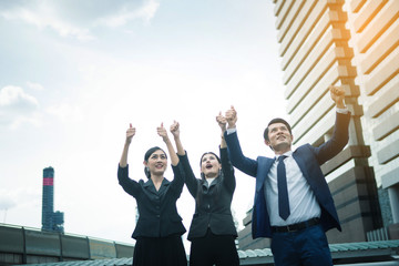 Business officers happy after success of teamwork