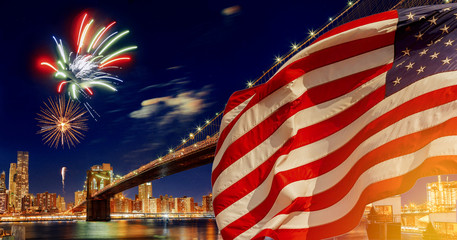 American flag flying the a Skyline view new york city manhattan downtown skyline at night