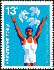 Ukraine - circa 2017: A postage stamp printed in Bulgaria shows drawing Athlete and doves. Circa 1984.