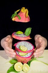 Pitaya or dragon fruit cut into slices which are flying
