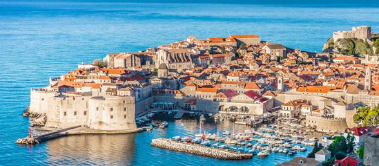 Dubrovnik townscape aerial panorama. / Aerial townscape of Dubrovnik city in Croatia, panorama view - Adriatic Sea scenery.