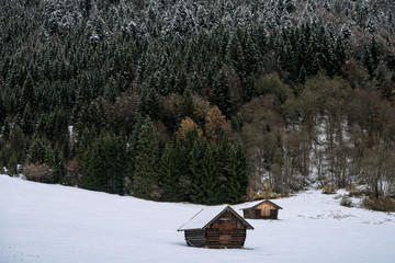 Wooden Cabins at lake Geroldsee in winter in Bavaria, Germany