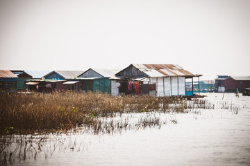 Homes on stilts on the floating village of Kampong Phluk, Tonle Sap lake, Siem Reap province, Cambodia