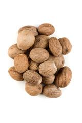 Fototapeta Pile of nutmeg seeds isolated on a white background obraz